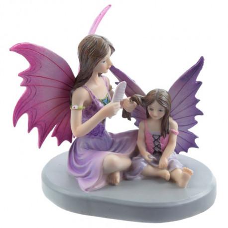 Figurine représentant 2 fées dans de jolis tons de rose et de mauve