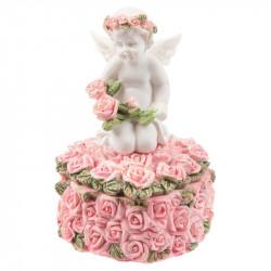 Cette boite avec un ange a la forme d'un coeur et elle est décorée de roses